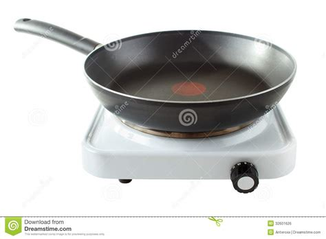 plaque chauffante cuisine plaque chauffante avec la casserole image libre de droits
