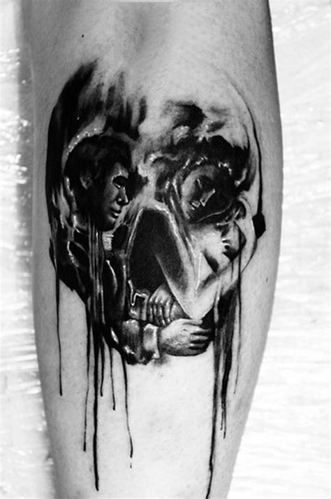 Skull shaped black and white sleeping couple tattoo on leg - Tattooimages.biz