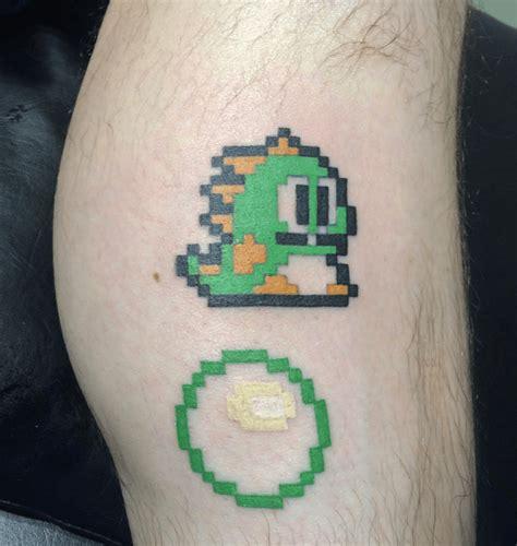 tatouage pixel retro gaming sur la peau tattoome le