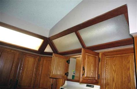 what to do with old and unusual soffit lighting in kitchen