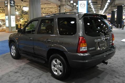 mazda tribute history pictures  auction sales