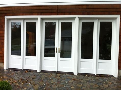 convert garrage door to windows converting a garage into a living space brick wall white glass door flooring
