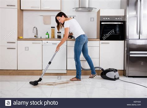 Woman Using Vacuum Cleaner Stock Photos & Woman Using Polished Laminate Flooring Fitting Under Skirting Boards Kitchener How Much Is Underlay For Free Light Brown Saw Blade Best Cleaner Hardwood Floors