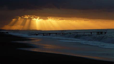 full hd wallpaper pier sea storm foam overcast light italy