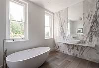 white marble bathroom Bathroom of the Week: In London, a Dramatic Turkish Marble Bathroom for a Design-Minded Couple ...