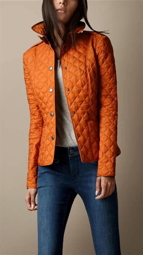 s burberry quilted jacket burberry heritage quilted jacket in orange lyst