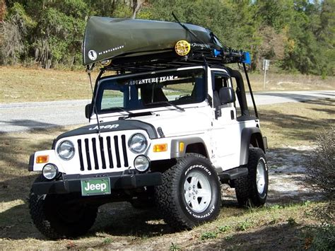 jeep kayak rack 14 ft canoe on a wilderness rack by garvin adventure and
