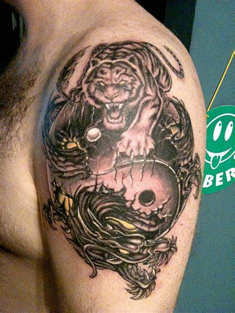 tiger  dragon yin  tattoo  left shoulder yin