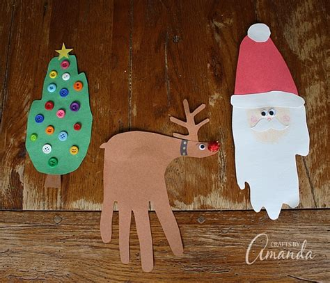 christmas decorations for toddlers with construction paper handprint crafts santa rudolph tree wreath