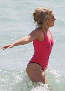 Tallia Storm in Neon Pink Swimsuit on the beach at Cannes