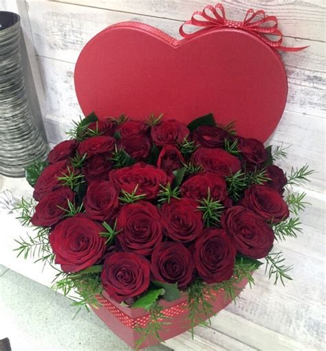 red roses   heart shaped gift box