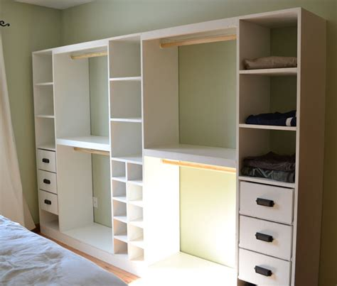 white build a master closet system shoe cubbies