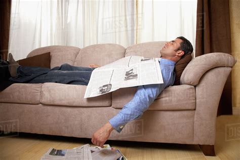 got a of couches sleep on the loveseat sofa tired businessman lying relaxed on sofa fall