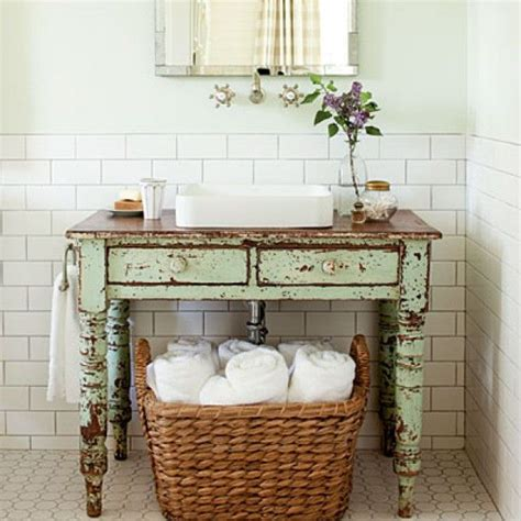 subway tile vintage furniture as vanity and a basket of white fluffy towels my