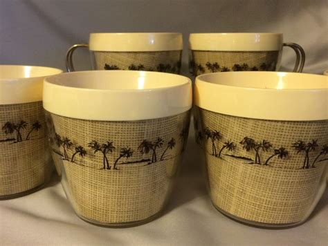 vintage thermal coffee cups  burlap  palm