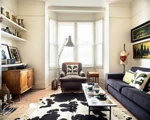 tapis peau de vache accessoire original pour votre interieur With tapis peau de vache avec canapé chesterfield moderne