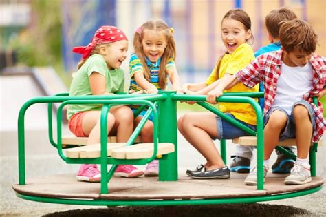 Kids Having Fun On Carousel Photo  Free Download