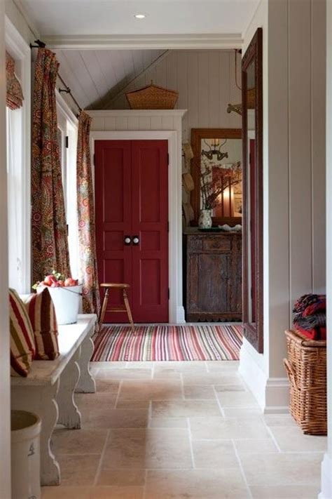 love  entryway red door tile floor  wood buffet