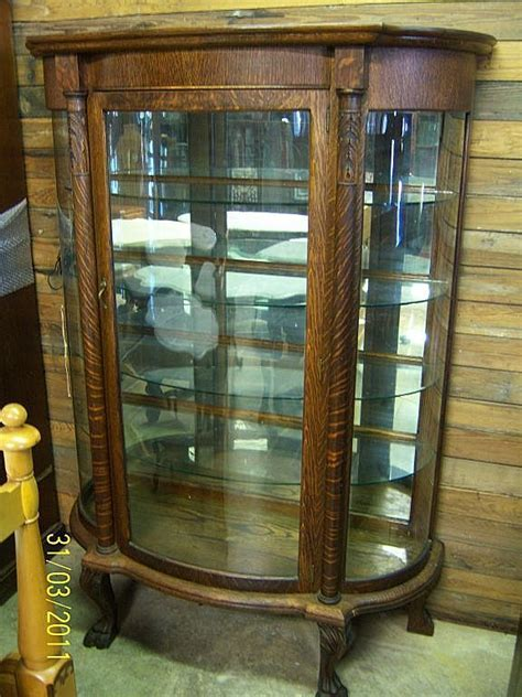antique china cabinets with curved glass with eagle claws