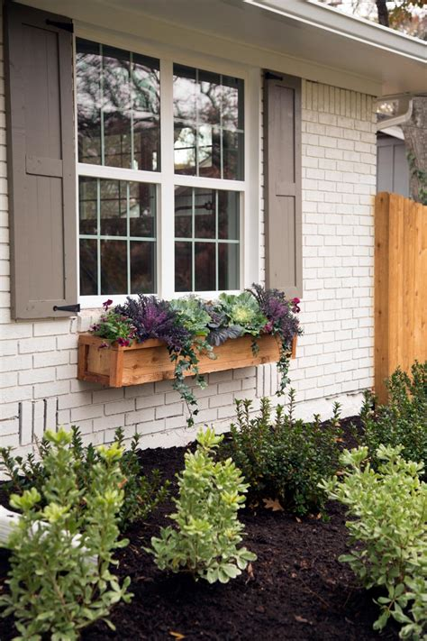 planter ideas for front of house floating block brown wooden planter box placed on the white brick wall plus glass window and