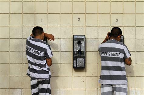 inmate phone calls inmates serving a sentence make a phone call at