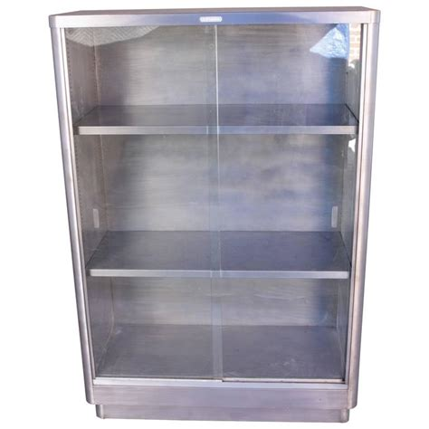 metal and glass bookcase industrial glass front metal bookcase at 1stdibs