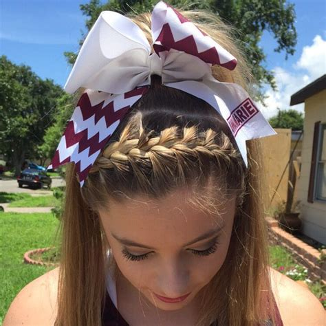 braided high pony tail cheer hair followed with a