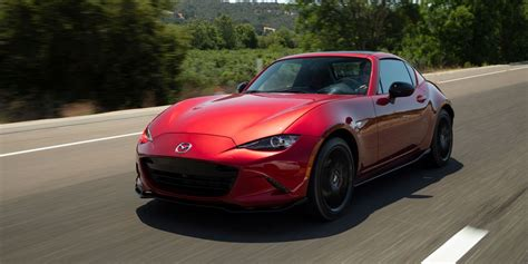mazda mx  miata review pricing  specs