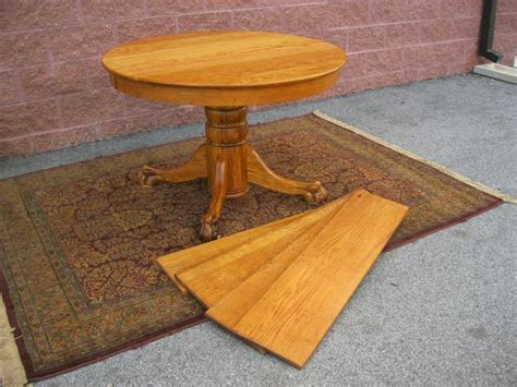 antique  solid oak lions paw foot dining table