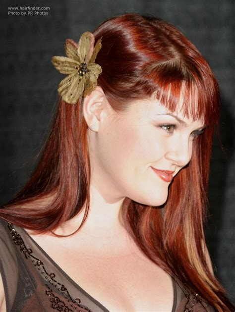 Pictures Of Hairstyles by Rue S Sleek Hair With A Flower Ear