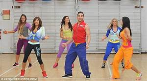 Jade Ewen upstages Louis Smith as she shows off washboard abs while launching Zumba fitness ...
