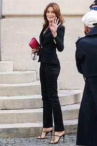 Carla Bruni-Sarkozy displays her trim figure and pert ...