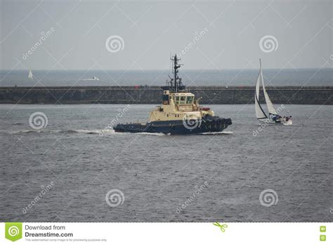 Small But Powerful Boat by Tugboat And Yacht Stock Photos Image 19199973