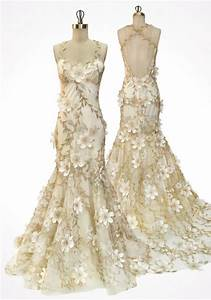 gold vines and ivory flowers scattered over tulle and silk With gold and ivory wedding dress