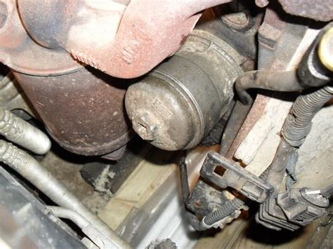 vectra    oil filter retaining cap removal