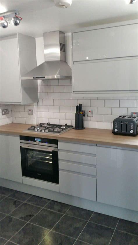 grey gloss kitchen white brick tiles  house
