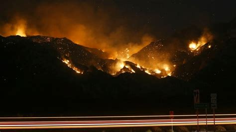 massive wildfires burn  arizona force evacuations