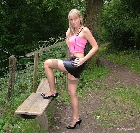 Blonde With Shapely Legs In Stockings And Heels Outdoors