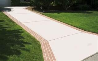 concrete driveway with brick borders driveway