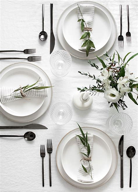 black and white dinner table setting set the table