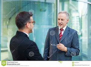 Two Business People Talking Together Stock Photo - Image ...