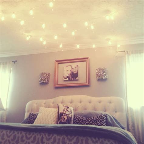 globe string lights above the bed home