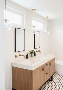 subway walls double mirrors with windows above With pendant lights over bathroom vanity