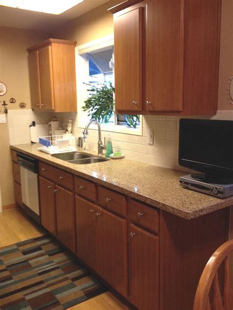 calypso brown prefab quartz counter with subway tile