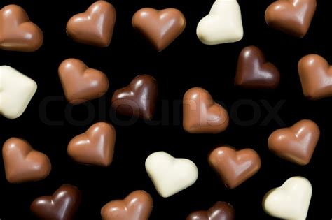 Chocolate Hearts Image by Chocolate Hearts On Black Background Stock Photo Colourbox