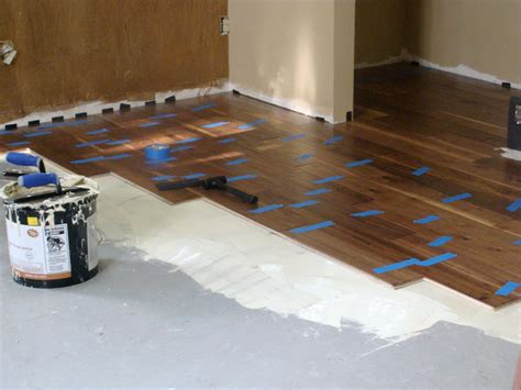 how to install wood floors on concrete installing hardwood flooring over concrete how tos diy