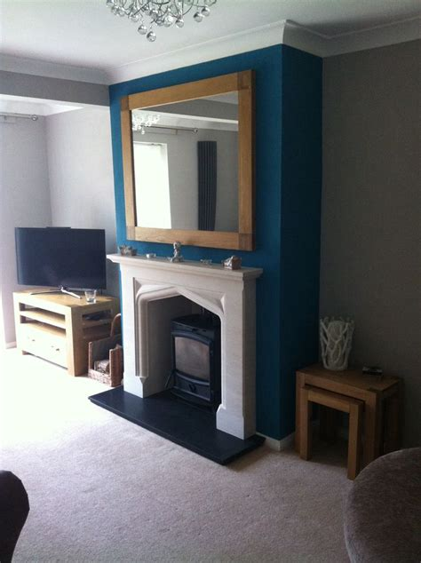 teal chimney breast living room   mustard living