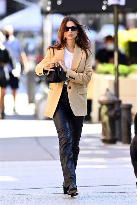 Emily Ratajkowski looks chic in a beige blazer and black ...