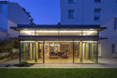 glassy modern extension rejuvenates georgian house  london
