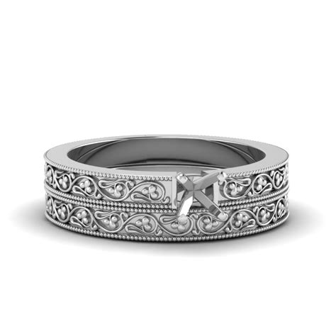 cushion cut diamond filigree vintage engagement ring with matching band in 18k white gold